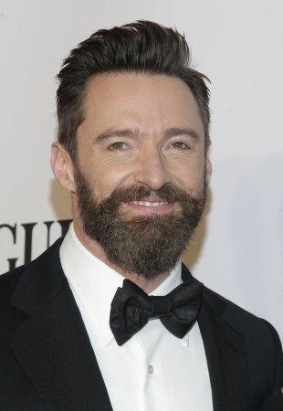 Hugh Jackman bounces into the Tony Awards show, teases Neil Patrick Harris