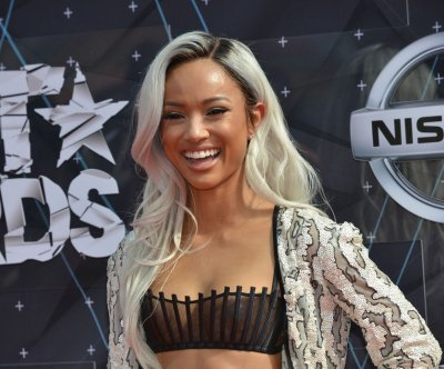 Karrueche Tran goes blonde for 2015 BET Awards