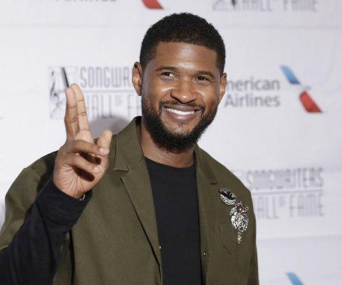 Usher announces midnight release for surprise album