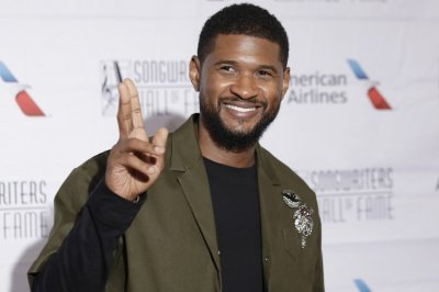 Usher announces midnight release for surprise album