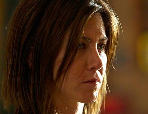 Jennifer Aniston says going without makeup for 'Cake' was 'empowering, liberating'