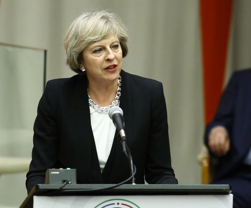 May tells EU leaders the UK expects to stay involved after Brexit