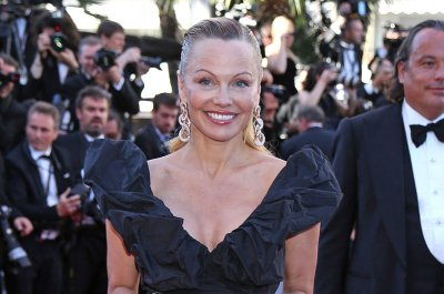 Pamela Anderson surprises with understated look at Cannes