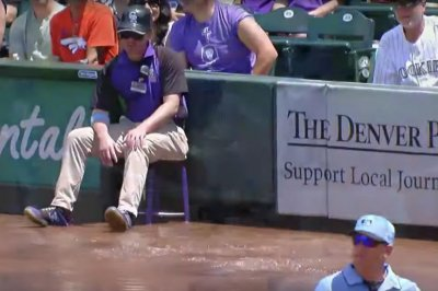 Rockies ball boy flooded by Coors Field sprinkler system