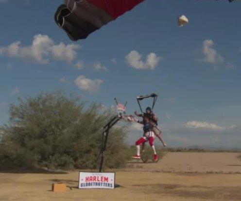 Harlem Globetrotter goes skydiving for world's highest slam dunk