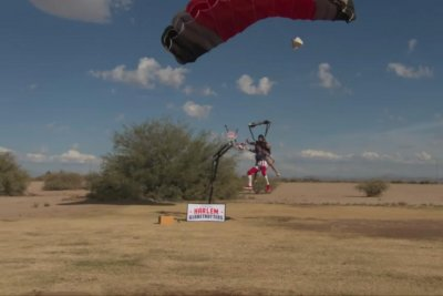 Harlem Globetrotter goes skydiving for world's highest slam dunk