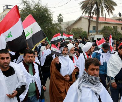Millions rally in Iraq to demand removal of U.S. military forces