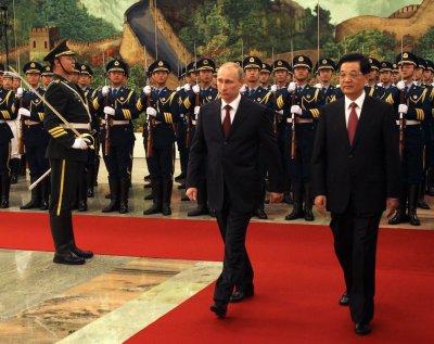 Putin visits China to attend Asian summit