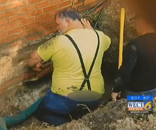 Fired worker says town manager shared 'butt crack' photo
