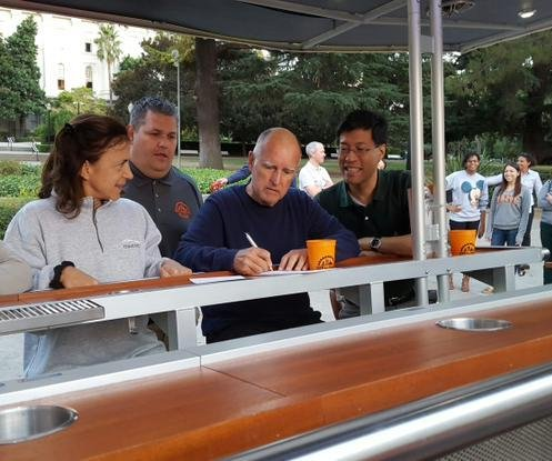 California governor signs 'beer bike' bill, takes a spin