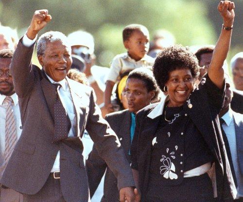 Grayed but unbowed, Mandela is freed