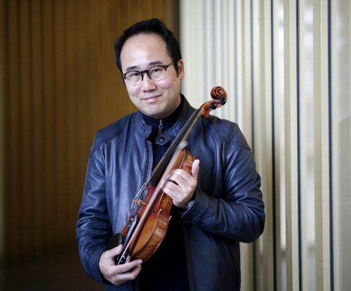 Violinist seeking peace through music finds hope, worry in Korea summits