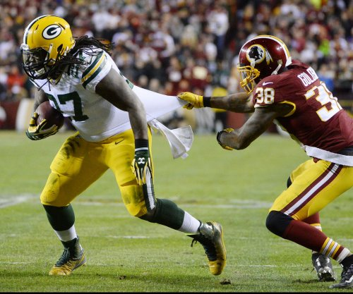 Green Bay Packers' coach Mike McCarthy plays the heavy with Eddie Lacy