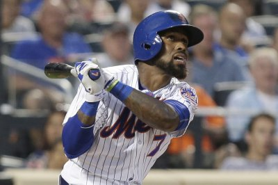 Jose Reyes helps New York Mets record 14th straight win over Cincinnati Reds