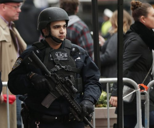 Police: NYC attack fueled by Mideast bombings, holiday poster