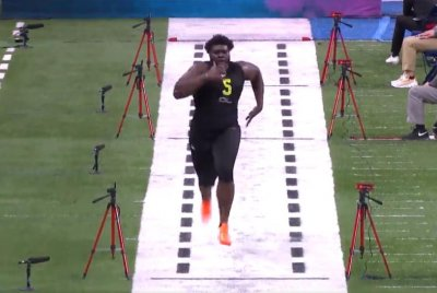 Ex-Louisville OT Mekhi Becton, largest prospect at combine, posts blazing 40 time