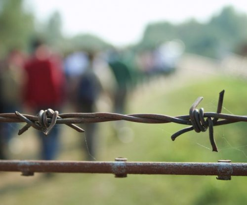 Hungary closes train station, erects razor-wire fence to stop migrants