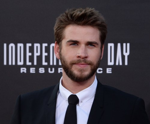Liam Hemsworth tells Conan about his trip on Woody Harrelson's bus