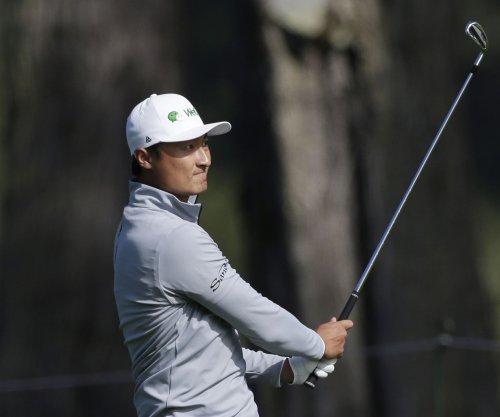 Haotong Li grabs Round 2 lead at PGA Championship; Tiger Woods makes cut