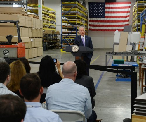 Biden visits Hollywood factory to promote minimum wage hike