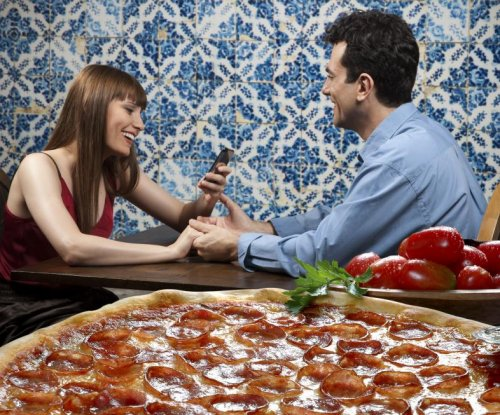 Eating to impress: Men eat more when dining with women