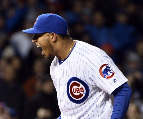 Chicago Cubs rally past Cincinnati Reds to win home opener
