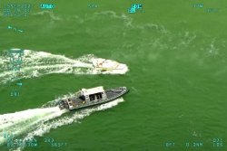 Florida deputies chase down runaway boat off popular beach