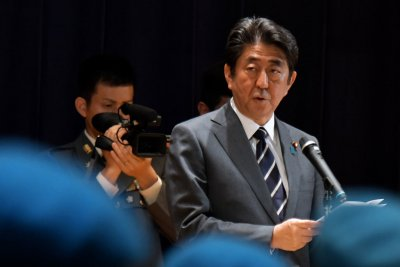 Shinzo Abe denounced for delayed response to North Korea test