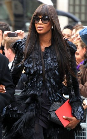 Naomi Campbell plugs for new Russian beau
