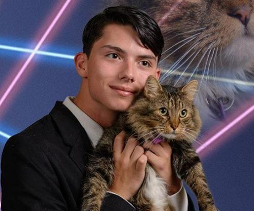 Teen known for 'laser cat' yearbook photo dies in apparent suicide