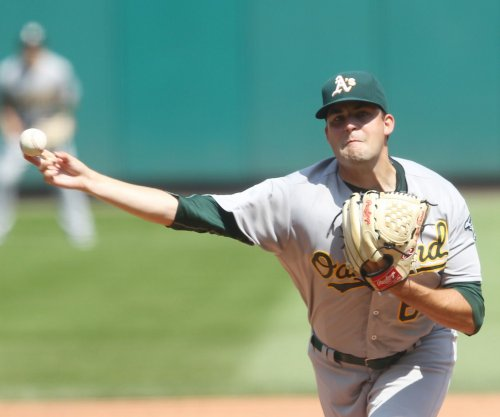 Well-traveled Andrew Triggs lifts Oakland Athletics past St. Louis Cardinals