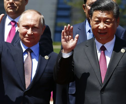 Putin praises China's Belt and Road initiative, condemns North Korea