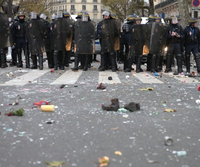 Paris attacks memorial damaged in climate change protest clashes with police