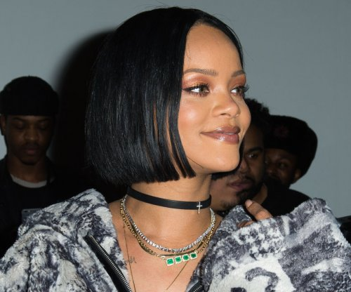 Rihanna cuts Grammy performance at last minute, apologizes
