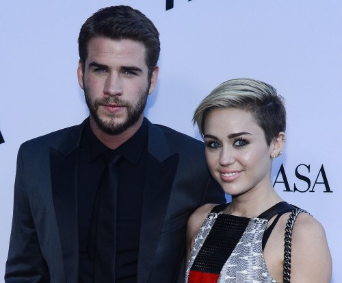 Miley Cyrus and Liam Hemsworth attend 'Huntsman' premiere