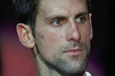 Novak Djokovic, Andy Murray advance in Madrid Open