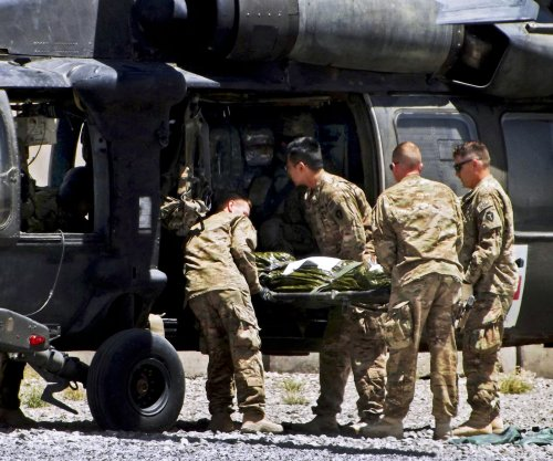 Two ISAF troops killed in Kabul bombings as Obama reaffirms withdrawal