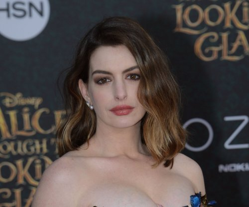Anne Hathaway, James Corden face off in rap battle