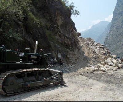 At least 30 dead in northern India landslides, flooding