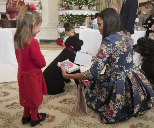 First lady emotional in kicking off final Obama White House holiday season