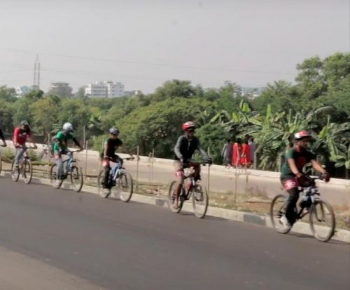 Cyclists in Bangladesh form world's longest line of moving bikes