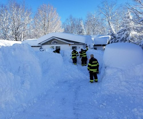 Firefighters rescue woman trapped in home by 6 feet of snow