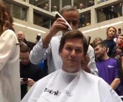 New England Patriots' Tom Brady shaves head for charity