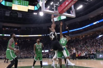 Giannis Antetokounmpo discards Kyrie Irving, jams on three Celtics