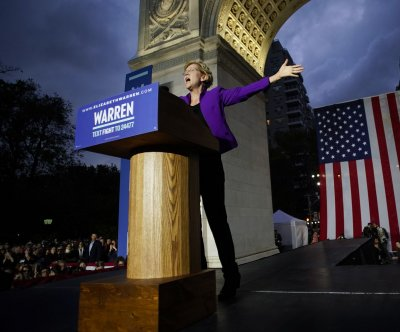 Elizabeth Warren vows to take corruption 'head-on' at New York rally