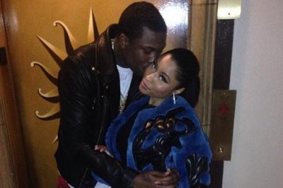 Nicki Minaj shares kiss photo with Meek Mill