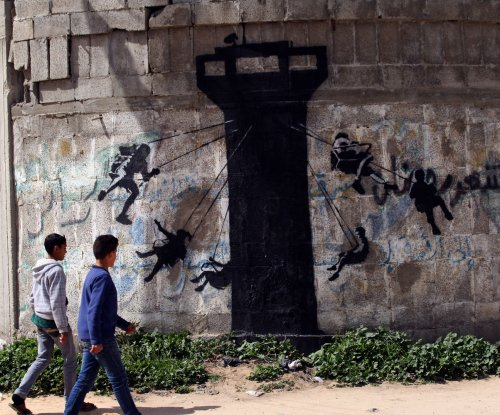 Banksy unveils new pieces on streets of Gaza