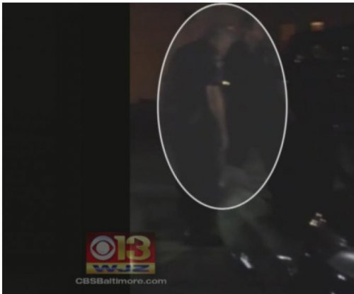 Baltimore officer investigated for spitting on handcuffed man