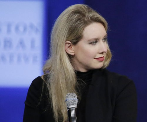 Blood-testing startup Theranos to lay off 41% of staff