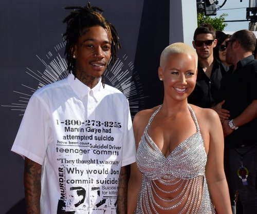 Amber Rose explains Wiz Khalifa kiss after Val Chmerkovskiy split